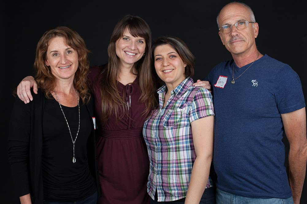 Four LACP Members smiling four the camera at a recent exhibition
